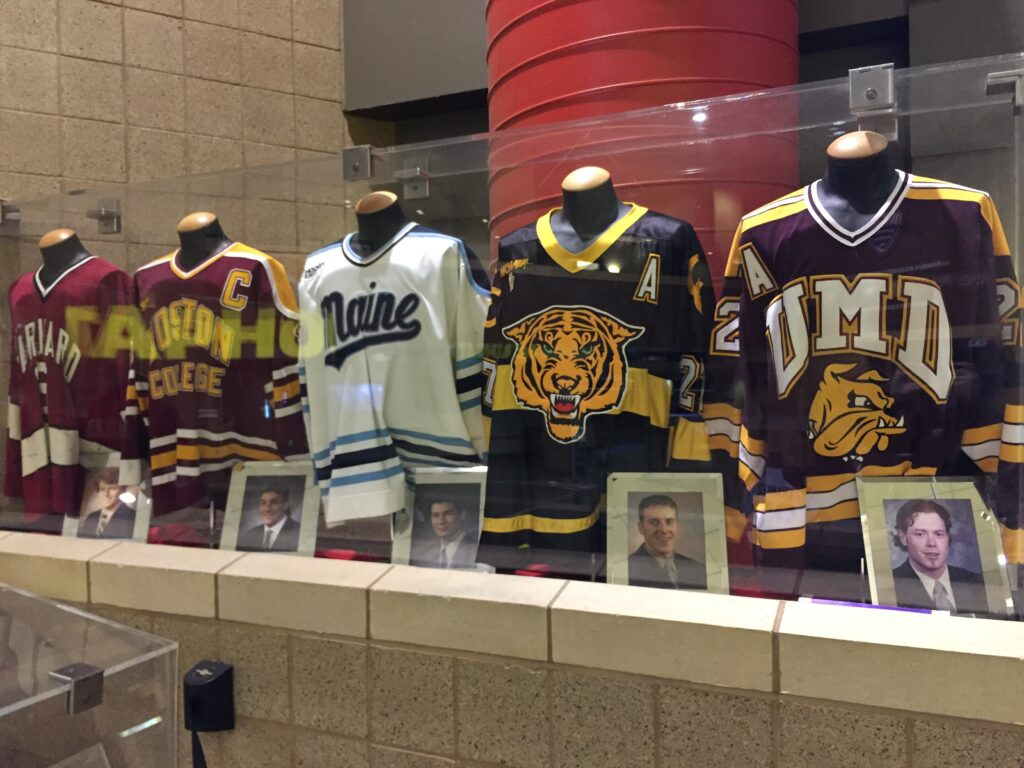 Jerseys of past Hobey Baker Award winners on display at the Xcel Energy Center